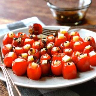 Mozzarella-Filled Cherry Tomatoes with Balsamic Glaze