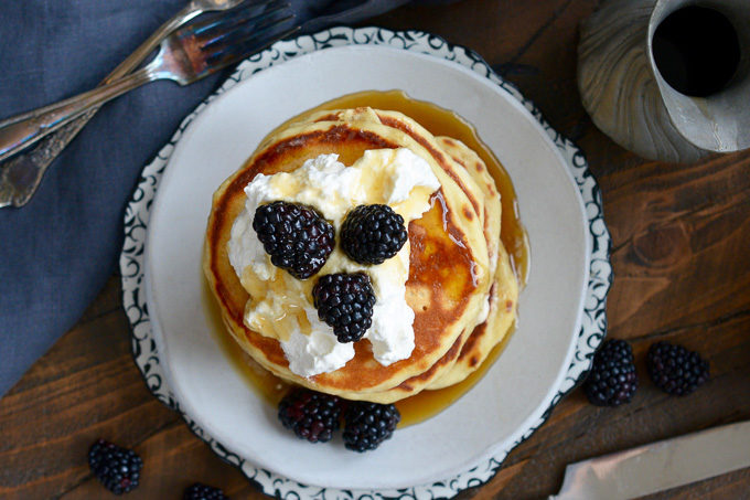 Bourbon Barrel Aged Maple Syrup Pancakes with Whipped Cream and Blackberries ciaochowbambina.com